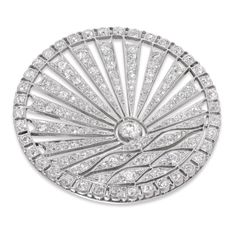 AN ART DECO CIRCULAR DIAMOND-SET SUNRISE BROOCH