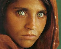 Afghan Girl [1984]   picture shot by National Geographic photographer Steve McCurry. Sharbat Gula was one of the students in an informal school within the refugee camp; McCurry, rarely given the opportunity to photograph Afghan women, seized the opportunity and captured her image. She was approximately 12 years old at the time. She made it on the cover of National Geographic next year, and her identity was discovered in 1992.