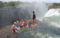 Andrew Yates and family at Victoria Falls - Sitting in a pool (DEVIL'S POOL) where the Zambezi River plunges into Victoria Falls. Jacuzzi, Safari Game, Victoria Falls, Travel Videos, Africa Travel, Adventure Travel, Places To Travel, Deck, Swimming