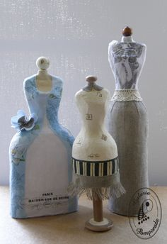 Mini mannequins made from strips of newspaper & white craft glue and a glass bottle as mold.  Make the dress from fabric and decorate it with lace, ribbon, sequins etc to make it prettier.