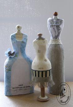 Vintage maniquíes hechos de papel maché en la botella.