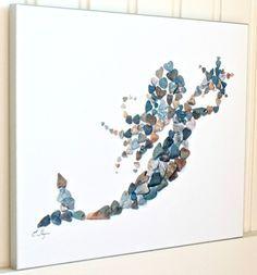 Mermaid art created with beach heart rock | Photograph: http://www.completely-coastal.com/2015/10/beach-heart-rock-art.html