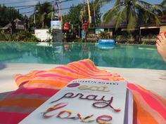 Reading Eat Pray Love at the pool! Great book