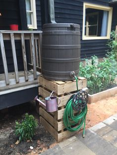 Rain barrel stand out of recycled pallets.
