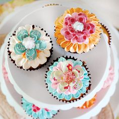 Cupcake decorating: The gorgeous home made paper mache flowers kids birthday cupcakes.
