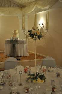Cream candelabra decorated at top and bottom