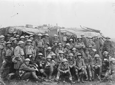 THIRD BATTLE YPRES PASSCHENDAELE 31 JULY - 10 NOVEMBER 1917 (E(AUS) 1071)   Assault on Passchendaele 12 October - 6 November: Most of the men (about forty only) left in the 8th Australian Battalion after the opening push of the second battle of Passchendaele on 26 October. Photograph taken as they were on their way from the trenches on 28 October and the men look dirty and grimly relieved.
