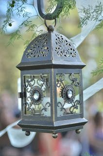 Decorate the ceremony aisle with non floral metal lanterns