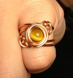 Copper wire wrapped ring with a blond tigers by RadFabrications, $15.00