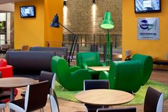 Feature rugs paired with colour coded giant angle-poise lamps were supplied by us alongside cafe furniture sourced from Italy.