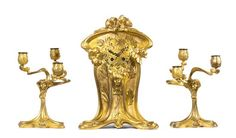A French Art Nouveau Gilt Bronze Three-Piece Clock Garniture, Height of clo