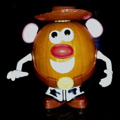 Small pumpkin, made into Toy Story character 'Woody' ...compliments to the makers of 'Mister Potato Head' for the shoes, belt, arms, eyes, nose, etc. Perfect idea for toddlers!