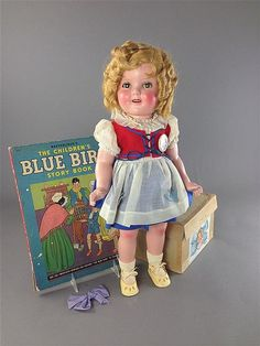 18' ORIGINAL COMPOSITION SHIRLEY TEMPLE 'BLUE BIRD' IN ORIGINAL BOX.  COMES WITH VINTAGE CHILDREN'S 'BLUE BIRD' STORYBOOK.  DOLL IS..