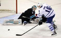 San Jose Sharks goaltender Antti Niemi deflects a shot off the stick of Toronto Maple Leafs' Richard Panik (Jan. 15, 2015).