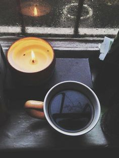 Coffee, rain and a burning candle: perfection