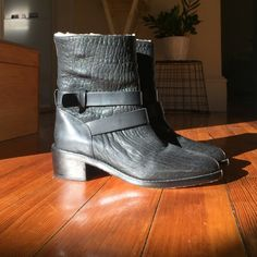 Loeffler Randall black shearling boot (Vesper) Very good condition, only one wear. Gorgeous and cozy shearling lined ankle boots!Embossed leather upper with strap detail. Smooth leather back quarter. Pull on design. Lamb fur lining. Padded leather insole. Stacked heel. Smooth leather outsole. Loeffler Randall Shoes Ankle Boots & Booties