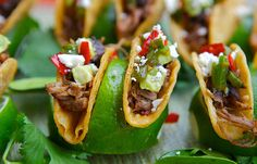 Here's a summer party idea: keep tasty, mini tacos upright in lime halves! #party #wolfgangpuck
