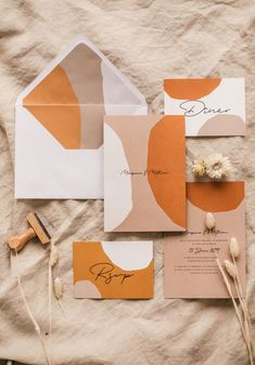 Orange, sandy blush, and white modern, sophisticated wedding invitation