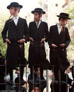 Well suited: Teenage boys from Jerusalem's Satmar hasidic community wear coats that may be similar to that bought by Ms Hooker when she visited Israel aged 18