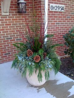 Winter Outside Planters pure gardener beautiful winter planters Source: website beautiful winter planter ideas house hawthornes Source. Outdoor Christmas Planters, Christmas Urns, Outdoor Christmas Decorations, Winter Christmas, Christmas Wreaths, Holiday Decor, Winter Porch, Winter Container Gardening, Container Plants
