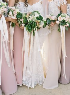 love mixed bridesmaid dresses and bouquets with long hanging ribbons