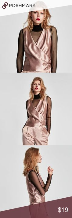 Zara Pink Satin Top, NWT Brand new in perfect condition, with tags still attached. Stunning pale pink satin top with a crossover v-neckline and draped detail.  Layer over a sheer black long sleeved shirt or wear just on its own.  Composition: 64% viscose, 36% polyester.  Millennial pink. Zara Tops