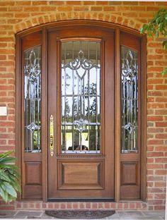 Door Style DbyD-1028.   This custom Mahogany entryway is installed in Opelika, Alabama.  The hardware is by Baldwin.