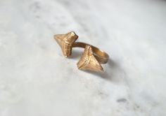 The K A R C H E R O S Incisor Ring. It features 2 hand cast, great white shark teeth hold the. Boho Jewelry, Jewelry Box, Jewellery, Great White Shark Teeth, Hand Carved, Gold Rings, Carving, Bling, Rose Gold