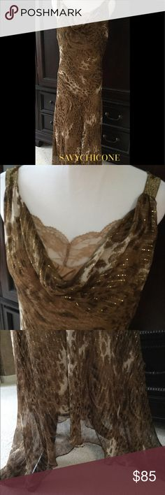🌺BEAUTIFUL SILK CHIFFON MAXI DRESS This dress is a gorgeous work of art!  Worn a couple of times.  Draped neckline with a peek a boo faux lace camisole.The material has gold metallic threads running through the subtle animal print-Beaded straps.  All lined in a silky soft to the touch fabric. Dresses Maxi