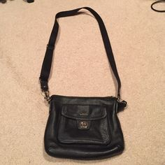 Black Coach cross body leather bag Black Coach cross body bag with extra pocket exterior. Gently used. Leather material. Zipper for bigger compartment. Small silver turning clasp for outside compartment. Coach Bags Crossbody Bags