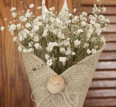 Fun and creative idea for pew markers. Burlap, button and Baby's Breath - an attractive and affordable combination.