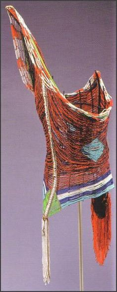 """Dinka mens corset from Sudan - RAND AFRICAN ART """"The tight beaded corsets indicate the men's position in the age-set system of the tribe. The corsets are first sewn in place at puberty and not removed until the wearer reaches a new age set. Each group wears a color-coded corset: a red and blue corset indicates a man between fifteen and twenty-five years of age; a yellow and blue one marks someone over thirty and ready for marriage."""""""