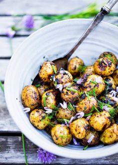 Grilled baby potato salad with Black garlic vinaigrette, dill and chive blossoms