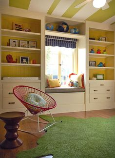 10. Modern and colorful California nursery. A few clever swipes of paint may be all you need to update your child's room. A striped ceiling, bright yellow bookshelves and bold textiles combine beautifully in this modern nursery.