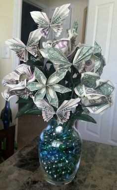Money Origami Bouquet! Made with $137. Money roses(5 bills each), butterflies (2…