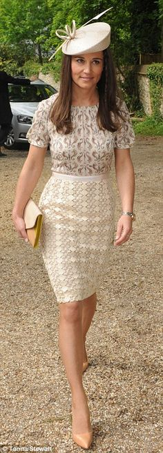 Pippa Middleton wearing the adelaide £370 dress by Tory Burch and a Whiteley hat, the same style as worn by her sister the Duchess of Cambridge at the wedding of Verity Evetts and Christopher Buchanan at the Church of St Peter and Holy cross