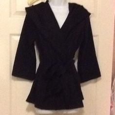BOUTIQUE ❤️Hooded wrap around 3/4 sleeve jacket 3/4 sleeve wrap around and ties at waist. Very warm for a 3/4 sleeve. Hood wears like a collar until you need it. Never worn except for pictures. NWOT Jackets & Coats