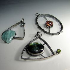 Weekend Pendants Eye of Decision, Passionate Heart Pendant and Bi-Aquamarine Pendant by sarawestermark, via Flickr