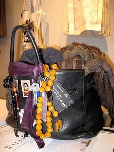 jane birkin's hermes birkin bag - I love that her bag is lived in and personalized. It's like a metaphor for a life well lived.