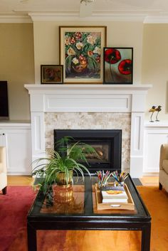 This family room fireplace has been beautifully appointed with clean lined trim work and marble subway tiles. we stylized the client's art collection for a casual display on the mantel. The coffee table is a throw back from the 80's which was stripped down, restrained and given a new life. Marble Subway Tiles, Family Room Fireplace, Round Ottoman, Trim Work, L Shape, Glass Table, Open Shelving, End Tables, Love Seat