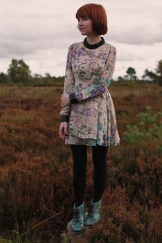 Something about this feminine floral dress paired with opaque black tights and heavy boots reads ethereal-meets-grunge. Love it! (Via The Cl...