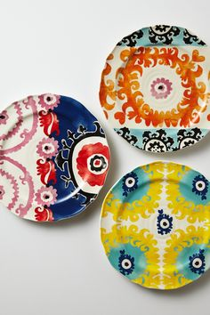 A plate (on the left) that has one pattern on half of it and another pattern on the other half. (Evita Dessert Plate - Anthropologie.com)