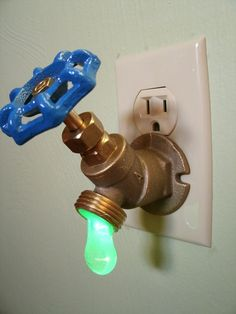 "Clever water faucet nightlight. Turning the valve actually turns on the 1/4 watt LED bulb in the hanging drop of ""water"""