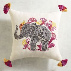 Exotic with modern appeal, our Embroidered Elephant Pillow dresses up your favorite chair or sofa with colorful style. It has tassels, textures and UV-resistant fabric that give it extra versatility with a worldly vibe.