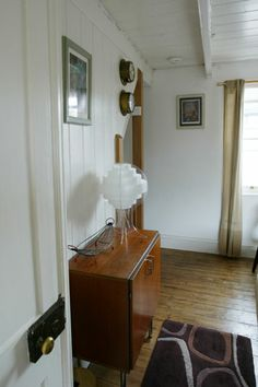 A cosy Mousehole holiday cottage with retro-inspired theme - original '60's Danish record cabinet functions as a sideboard