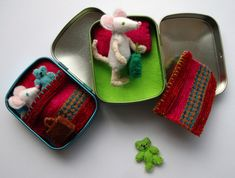 Tins of tiny felt mice with blankets, suitcases and teddy bears. Hand crafted at Little Irish House. Find on facebook