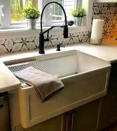 """Recently remodeled kitchen by Collette in NH! The sink is Julien's """"Fira Apron Front"""" Fireclay Sink and the faucet is Brizo's Solna Smart Touch in matte black.  Stop by and shop Collette's kitchen remodel at your local Ultimate Bath Store!"""