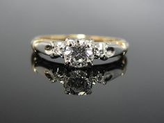 Hey, I found this really awesome Etsy listing at http://www.etsy.com/listing/117953732/1940s-floral-motif-engagement-ring-two