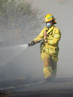 Fire fighter spraying water on a bush fire in an suburban area of Knox City in M , #affiliate, #fire, #bush, #area, #suburban, #fighter #ad