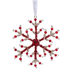 Add a touch of simple elegance to your holiday decor with this delightful handmade brass wire and glass ornament. Expertly crafted into a delicate snowflake shape, it begins with concentric stars at t